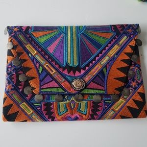 Fabric clutch with coin detail